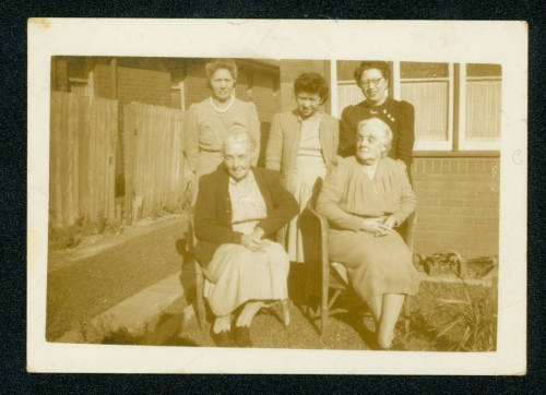 413 Barbara-Stephenson-and-Amy-Connolly-seated-with-members-of-the-Liu-family